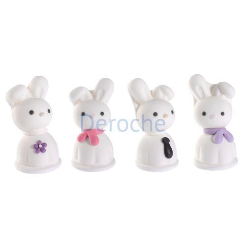 4 petits lapins blancs en sucre